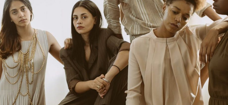 photo of women posing while looking serious